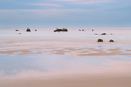Delicate dusk on a sandy beach with rocks, Cantabria, Spain<br /> <br /> Zarte Abenddämmerung an einem Sandstrand mit Felsen, Cantabria, Spain