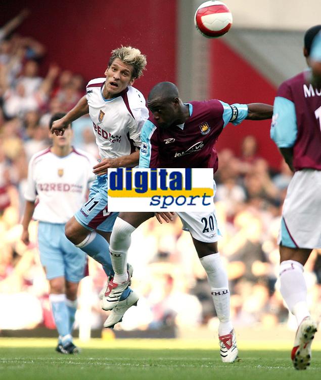 Photo: Chris Ratcliffe.<br /> West Ham United v Aston Villa. The Barclays Premiership. 10/09/2006.<br /> Stilian Petrov of Aston Villa clashes with Nigel Reo-Coker of West Ham.