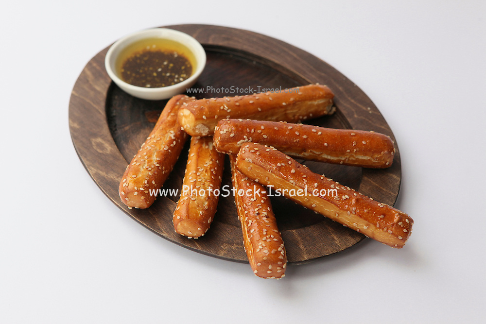 Grissini (Breadsticks) on wood plate and dip