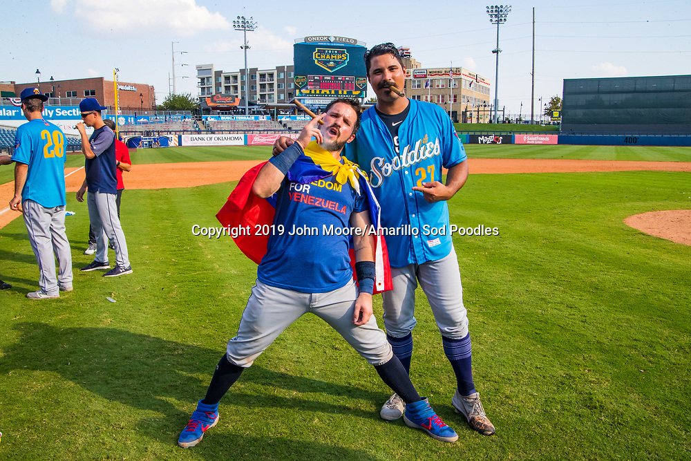 Amarillo Sod Poodles catcher Luis Torrens (21) and Amarillo Sod Poodles pitcher Travis Radke (27) celebrate after winning against against the Tulsa Drillers during the Texas League Championship on Sunday, Sept. 15, 2019, at OneOK Field in Tulsa, Oklahoma. [Photo by John Moore/Amarillo Sod Poodles]