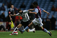 Photo: Lee Earle.<br /> Aston Villa v Fulham. The Barclays Premiership. 21/10/2006. Fulham's Moritz Volz (L) battles with Liam Ridgewell.