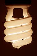 close up of an illuminated energy savings light bulb