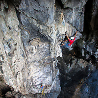 """Phairat """"Muad"""" Kaewkan leading the airy first pitch of Anxiety State Crisis, 7a, Crazy Horse Buttress, Chiang Mai, Thailand"""