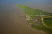 Nederland, Groningen, Reider Buitenland, 08-09-2009; Punt van Reide, schiereiland in de  mond van de Dollard (onderdeel van de Eems). In het verleden liep kustlijn (oeverwal) hier door naar Duitsland. De contouren van de zeedijk (Deltadijk) zijn zichtbaar door dienstweg..Natuurgebied, in beheer bij het Groninger Landschap..Point of Reide, peninsula in the mouth of the Dollard (part of the Ems). In the past the coastline (levee) ran from here to Germany..luchtfoto (toeslag); aerial photo (additional fee required); .foto Siebe Swart / photo Siebe Swart
