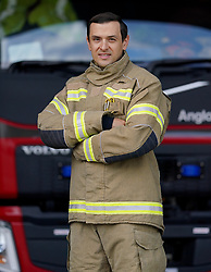 Former football player now fire fighter, Alex Nicholls poses for a picture at the Haden Cross fire station in Halesowen, Birmingham. After nine clubs, 66 goals and 429 appearances former forward Nicholls walked away from the game completely to become a firefighter Issue date: Wednesday October 6, 2021.