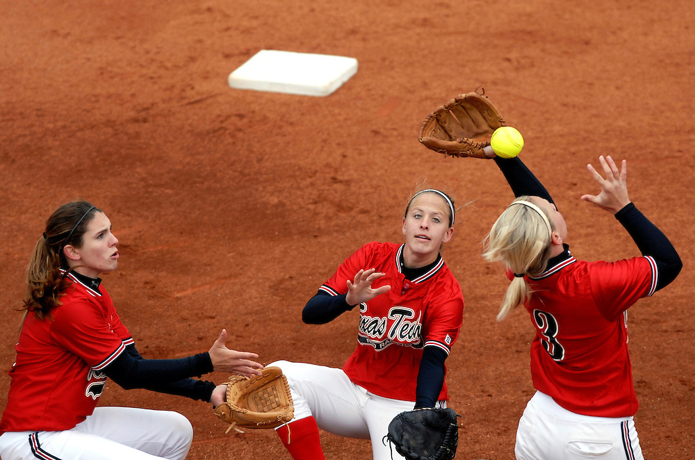 (Left to right) Texas Tech's Leah Legler (4), Liz Eimen (5), and Jennifer Bowers (3) converge on a pop fly in the infield during the first inning against Missouri.  The error advanced the Tiger's Julie Silver to first base.  Missouri beat Tech 5-3 in game one and swept the weekend series with a 10-6 win in game two.