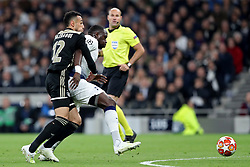 April 30, 2019 - London, England, United Kingdom - Tottenham midfielder Moussa Sissoko holds off a challenge from Ajax defender Noussair Mazraoui during the UEFA Champions League match between Tottenham Hotspur and Ajax Amsterdam at White Hart Lane, London on Tuesday 30th April 2019. (Credit Image: © Mi News/NurPhoto via ZUMA Press)