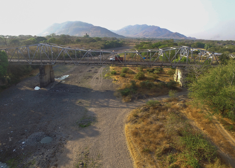 Rio Chiquito, Nacaome, Honduras, with holes where sand is being extracted for building.