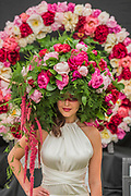 Models wear hats made of Peonies on the Primrose Hall flower stand - The Chelsea Flower Show organised by the Royal Horticultural Society with M&G as its main sponsor for the final year. London 22 May, 2017