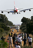 PERTH, AUSTRALIA - OCTOBER 14:  The new Qantas A380 lands in Perth for the first time following it's arrival in Australia on September 21, at the Perth International Airport on October 14, 2008 in Perth, Australia. The plane was on a promotional trip to the city, which it departed again this afternoon. It is one of the first 20 A380's ordered by Qantas.  (Photo by Paul Kane/Getty Images)