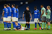 Football - 2020 / 2021 Premier League - Brighton & Hove Albion vs Everton - Amex Stadium<br /> <br /> Brighton & Hove Albion's Leandro Trossard lies behind the wall as Referee Darren England looks on<br /> <br /> COLORSPORT/ASHLEY WESTERN