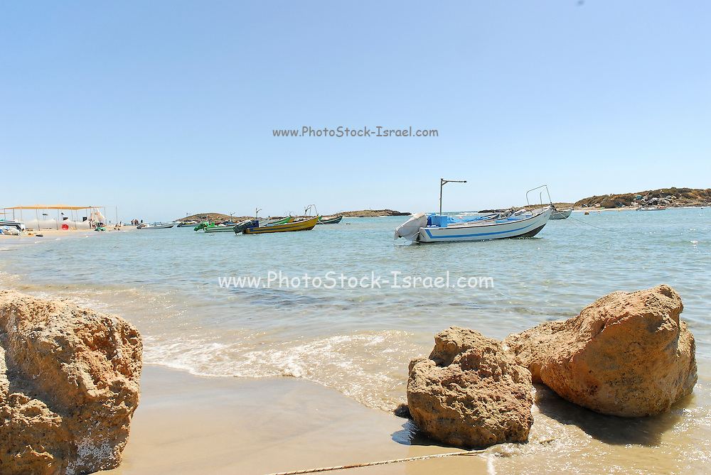 Israel, Achziv Beach, Fishing boats in a small natural harbour