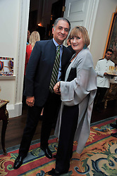 Designer ALI DAD and SUE CREWE at a party to celebrate the publication of Gosling - Classic Design for Contemporary Interiors by Tim Gosling held at William Kent House, The Ritz Hotel, London on 1st October 2009.