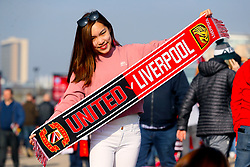 Fans pose with half and half scarf ahead of the match
