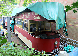 "Southampton,Hampshire . A man was crushed to death by the vintage tram he was converting into a mobile cafe and ice-cream parlour, an inquest has heard.<br /> <br /> Engineer and vintage vehicle enthusiast George Manser, 63, was killed while restoring the tram at his workshop in Sarisbury Green, Hampshire, in May.<br /> <br /> It was up on a jack when it topped over crushing Mr Manser against metal steps by a nearby wall.<br /> <br /> A Portsmouth coroner recorded a verdict of accidental death.<br /> Image caption The converted tram remains at the workshop where the accident happened<br /> <br /> Mr Manser had hoped to visit shows with the converted tram.<br /> <br /> He was checking its tyres prior to the accident, ahead of the vehicle's MOT.<br /> <br /> It was raised about 2ft (0.6m) when it started to topple and the jack gave way, the inquest heard.<br /> <br /> Following the verdict, his brother Bill Manser said he had been ""in the wrong place at the wrong time"".<br /> <br /> He described him as a ""very kind and caring man"" who loved trying to keep old machines alive.<br /> <br /> He added the family hoped his death would ""remind people to check their equipment and workspace, especially when working with heavy vehicles"". ©UKNIP"