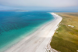 Aerial view from drone of white sand beach on west coast of island of Berneray in the Outer Hebrides, Scotland, UK