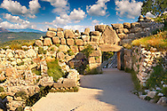 Mycenae Lion Gate & citadel walls built in 1350 B.C and known as cyclopean style walls due to the vast size of the blocks it was assumed by visitors in ancientb times that only giant Cycopse could have built them. Excavated by the archaeologist Heinrich Schliemann in 1876.  Mycenae UNESCO World Heritage  Archaeological Site, Peloponnese, Greece . <br /> <br /> Visit our MYCENAEN ART PHOTO COLLECTIONS for more photos to download  as wall art prints https://funkystock.photoshelter.com/gallery-collection/Pictures-Images-of-Ancient-Mycenaean-Art-Artefacts-Archaeology-Sites/C0000xRC5WLQcbhQ<br /> .<br /> <br /> Visit our GREEK HISTORIC PLACES PHOTO COLLECTIONS for more photos to download or buy as wall art prints https://funkystock.photoshelter.com/gallery-collection/Pictures-Images-of-Greece-Photos-of-Greek-Historic-Landmark-Sites/C0000w6e8OkknEb8