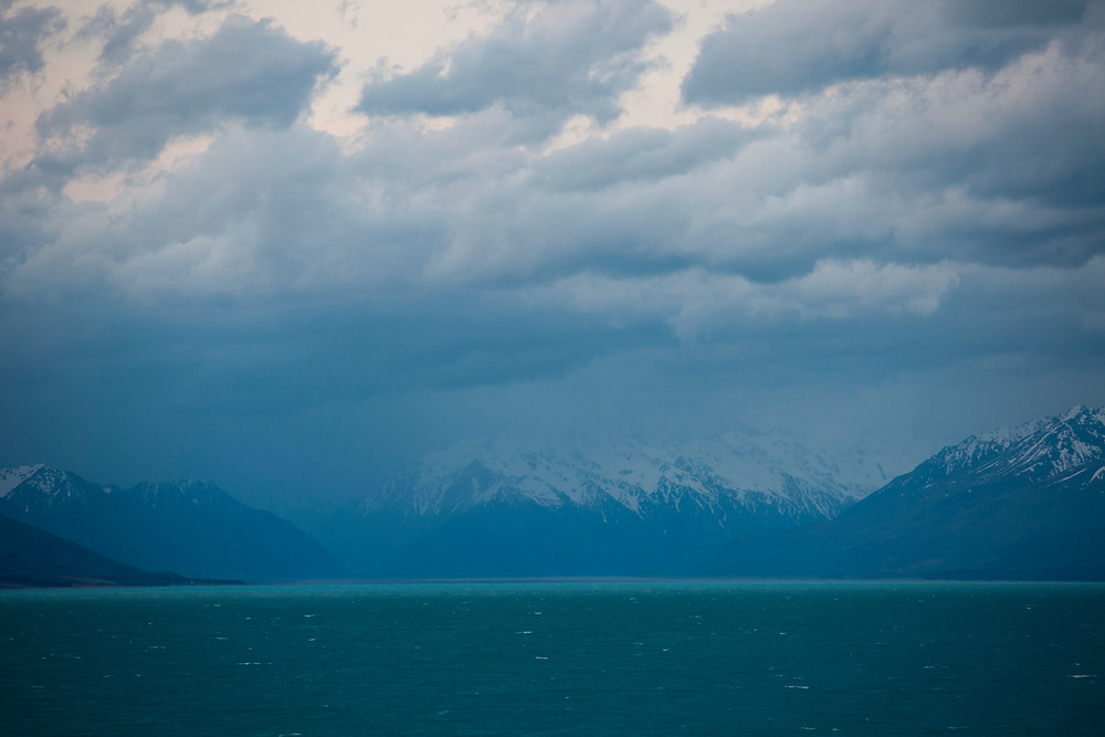 View overlooking Lake Pukaki, Mackenzie Country,<br /> South Island, NZ, looking towards snowy mountains of the Mt Cook region.