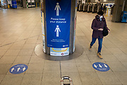 The day after the government introduced a third Coronavirus pandemic national lockdown, effectively a Tier 5 restriction, passengers walk through the concourse of Westminster station where social distance sign urge transport users to stay distanced as the country experiences a grim post-Christmas and millions of Britons are told to stay at home, on 5th January 2021, in London, England.