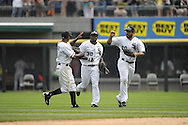 CHICAGO - JULY 27:  Juan Pierre #1 (L), Alejandro De Aza #30 (C) and Carlos Quentin #20 (R) of the Chicago White Sox celebrate after the game against the Detroit Tigers on July 27, 2011 at U.S. Cellular Field in Chicago, Illinois.  The White Sox defeated the Tigers 2-1.  (Photo by Ron Vesely)  Subject: Juan Pierre;Alejandro De Aza;Carlos Quentin
