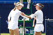 Anna Blinkova of Russia and Bibiane Schoofs of Holland embrace after Schools' victory in the Women's Singles Quarter Final during the Fuzion 100 Ilkley Lawn Tennis Trophy Tournament held at Ilkley Lawn Tennis and Squad Club, Ilkley, United Kingdom on 19 June 2019.