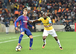 Mamelodi Sundowns player Hlompho Kekana and Barcelona FC player Denis Suarez battle for the ball during Mandela Centenary Cup at FNB stadium, Gauteng.<br />Picture: Itumeleng English/African News Agency (ANA)