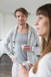 Couple holding cup of coffee
