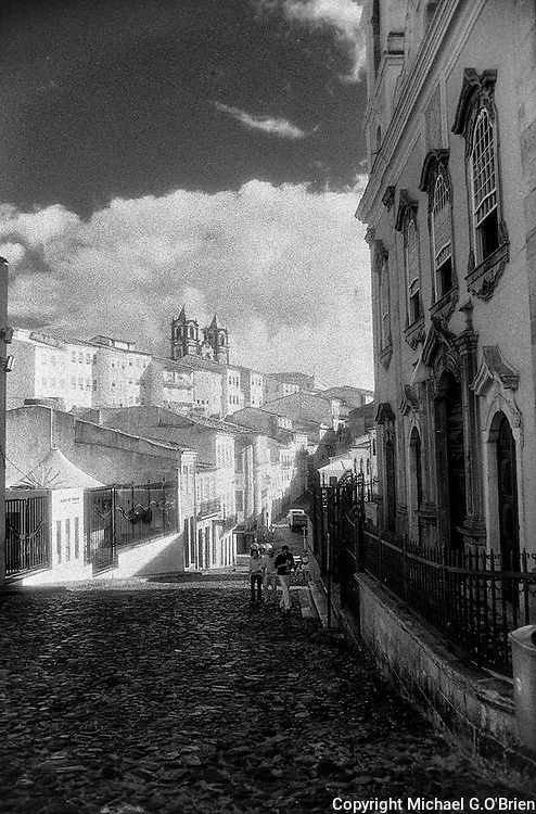 Looking down the hill into the Pelourinho neighborhood in Salvador de Bahia, Brazil. The name pelourinho refers to a post/pillar that slaves were tied to and whipped. For many decades the Pelourinho Hotel had a metal sculpture, in their courtyard, depicting a man whipping another tied to the pillar. It has been removed.