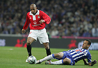 """PORTUGAL - PORTO 28 FEBRUARY 2005: EVERSON SILVA #18(L) and LUIS FABIANO #9(R) compete for the ball, in the 23 leg of the Portuguese soccer league """"Super Liga"""" FC Porto (1) vs SL Benfica (1), held in """"Dragao"""" stadium  28/02/2005  21:35:03<br />(PHOTO BY: NUNO ALEGRIA/AFCD)<br /><br />PORTUGAL OUT, PARTNER COUNTRY ONLY, ARCHIVE OUT, EDITORIAL USE ONLY, CREDIT LINE IS MANDATORY AFCD-PHOTO AGENCY 2004 © ALL RIGHTS RESERVED"""