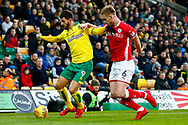Barnsley defender Liam Lindsay (6) Norwich City striker Nelson Oliveira (9) battles for possession during the EFL Sky Bet Championship match between Norwich City and Barnsley at Carrow Road, Norwich, England on 18 November 2017. Photo by Phil Chaplin.