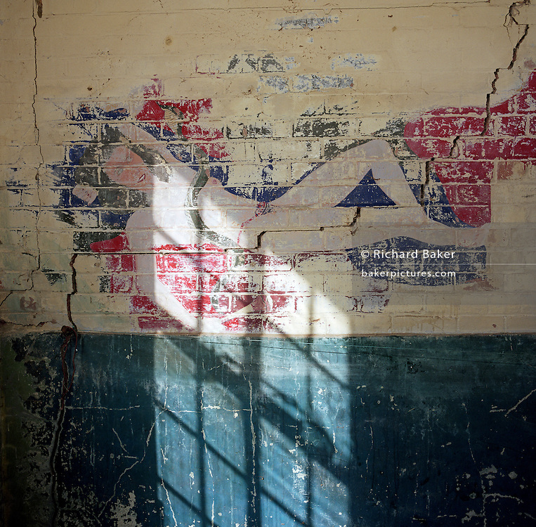 A wall mural painting of a sexy woman at the former WW2 Flixton air force base in Suffolk, England. Flixton was the home of the 706th Bombardment Squadron, an operational squadron of the 446th Bombardment Group (Heavy). The 446th operated chiefly against strategic objectives on the Continent from December 1943 until April 1945. Targets included U-boat installations at Kiel, the port at Bremen, a chemical plant at Ludwigshafen, ball-bearing works at Berlin, aero-engine plants at Rostock, aircraft factories at Munich, marshalling yards at Coblenz, motor works at Ulm, and oil refineries at Hamburg. After the war, the buildings reverted to agricultural and industrial use.