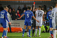 Peterborough United defender Rhys Bennett (16) red card, sent off during the EFL Sky Bet League 1 match between AFC Wimbledon and Peterborough United at the Cherry Red Records Stadium, Kingston, England on 12 March 2019.
