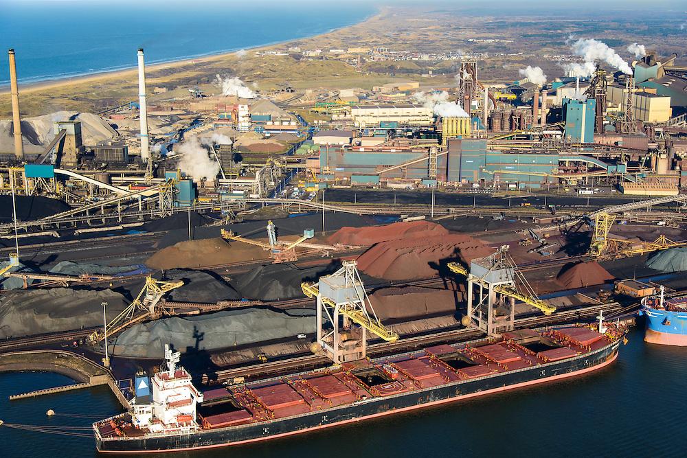 Nederland, Noord-Holland, IJmuiden, 11-12-2013; Tata Steel, zicht op de cokesfabriek en de laatste 2 hoogovens (re). Links bulkcarrier en opslag van kolen, cokes, erts. Voorheen Corus, Hoogovens<br /> Tata Steel, view of the coke plant and the last two blast furnaces. To the left bulk carrier and storage of coal, coke, ore. Formerly Corus Hoogovens<br /> luchtfoto (toeslag op standaard tarieven);<br /> aerial photo (additional fee required);<br /> copyright foto/photo Siebe Swart.