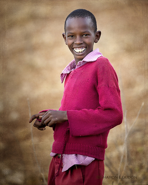 Smiling young herder, outside Amboseli