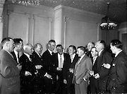 15/05/1959<br /> 05/15/1959<br /> 15 May 1959<br /> Annual General Meeting of Comhaltas Cana (Customs and Excise) at Jury's Hotel, Dublin. Picture shows (l-r) G.F. Mullins; M. Carroll (Cork); J. Devlin (Cork); E.S. O'Fathaigh (Cork); S.V. Mallen (Limerick) President; M. Fitzgerald (Dublin); D. Smyth (Kilkenny); J. Foley (Shannon Airport); T. Mac Gabhann (Roscrea); S.E. O'Ceallaigh (Dublin) and W. Kennedy chatting during a luncheon interval.