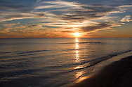 Sunset photo of the Biloxi Mississippi Gulf Coast beach.