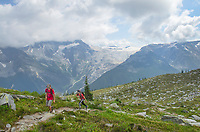 Two teenage male hikers on Abbott Ridge Trail. Illecillewaet Glacier is in the distance. Selkirk Mountains Glacier National Park British Columbia