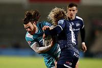 Rugby Union - 2020 / 2021 Gallagher Premiership - Sale Sharks vs Worcester Warriors - AJ Bell Stadium<br /> <br /> Oli Morris of Worcester Warriors is tackled by Faf De Klerk of Sale Sharks<br /> <br /> COLORSPORT/PAUL GREENWOOD