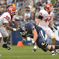 Oct 31, 2009; East Hartford, CT, USA; Connecticut tackle Mike Ryan (71) blocks Rutgers defensive end Jonathan Freeny (99) during second half Big East NCAA football action in Rutgers' 28-24 victory over Connecticut at Rentschler Field.