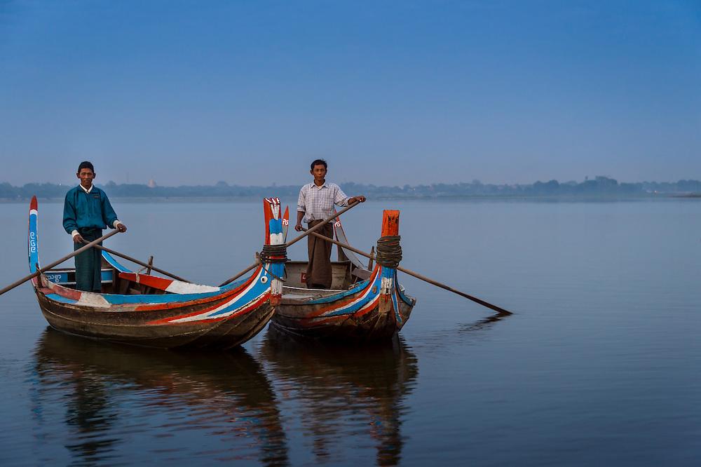 MANDALAY, MYANMAR - CIRCA DECEMBER 2013:  Typical paddle boats in  the Taungthaman Lake near Mandalay