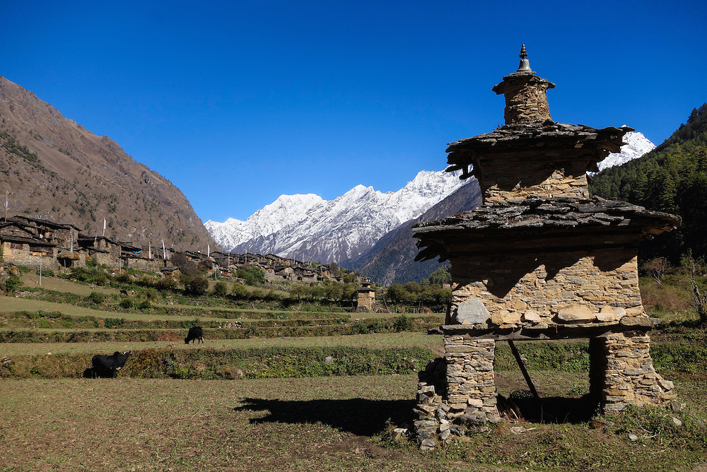 Stupa and the village of Ripchet in the Tsum Valley, Nepal.