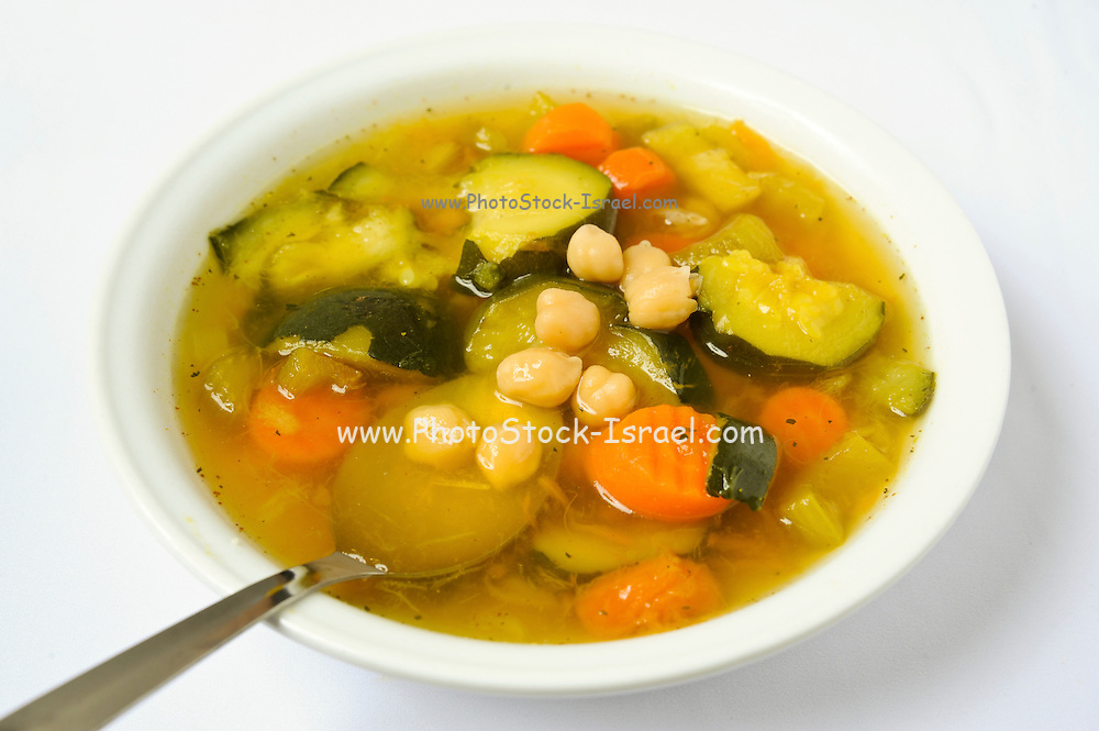 A plate of vegetable soup