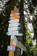 Polish hiking route signs that show heights, walking times and km distances, on 20th September 2019, Obidza, near Szczawnica, Malopolska, Poland.