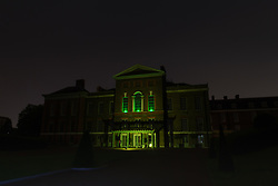 Three green lights in the windows of Kensington Palace in London commemorate the 72 victims of the Grenfel Tower fire on its first anniversary. London, June 14 2018.