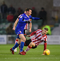 Lincoln City's Michael O'Connor vies for possession with Morecambe's Liam Mandeville<br /> <br /> Photographer Chris Vaughan/CameraSport<br /> <br /> The EFL Sky Bet League Two - Saturday 15th December 2018 - Lincoln City v Morecambe - Sincil Bank - Lincoln<br /> <br /> World Copyright © 2018 CameraSport. All rights reserved. 43 Linden Ave. Countesthorpe. Leicester. England. LE8 5PG - Tel: +44 (0) 116 277 4147 - admin@camerasport.com - www.camerasport.com