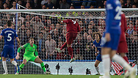 Football - 2018 / 2019 Premier League - Chelsea vs. Liverpool<br /> <br /> Roberto Firmino (Liverpool FC) rises unmarked to head towards the Chelsea goal at Stamford Bridge <br /> <br /> COLORSPORT/DANIEL BEARHAM