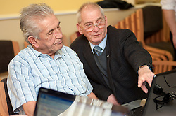 Digital Region Co-Running a series of workshops to equip the elderly with basic computer skills at Bakersfield Court sheltered housing on Longfellow Drive Rotherham- Ron Roberts is helped by Reg Margetts (right)..21 March 2011.Images © Paul David Drabble