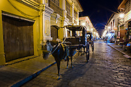 Kalesa on the street in Vigan at night.<br /> Ilocos Sur and Ilocos Norte are the Filipino provinces situated on Luzon Island and famous for heritage town of Vigan, windmills of Bangui, white sand beach of Pagudpud not to mention former president Marcos, who was born there.