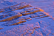 Rock and abstract at sunset. The flow of water narrows between Lovesick Lake and Lower Buckhorn Lake on the west and Stoney Lake to the east creating Burleigh Falls. Kawartha Lakes. <br />Burleigh Falls<br />Ontario<br />Canada