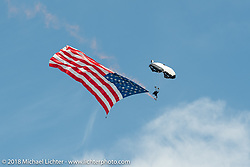 Parachuting down to Main Street with a giant American Flag during the 78th annual Sturgis Motorcycle Rally. Sturgis, SD. USA. Tuesday August 7, 2018. Photography ©2018 Michael Lichter.